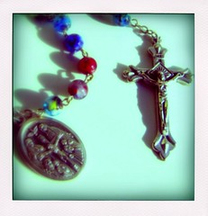 rosary (lookie.lew) Tags: blue red yellow catholic christ bokeh prayer jesus medal crucifix rosary simple jesuschrist glassbeads holyrosary hailmary poladroid cmwdblue