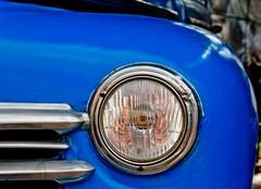 The blue beaut (Sharon's Shotz) Tags: blue winter car interestingness classiccar cuba explore headlight lightroom cameraraw vintageautomobile royalblue winterescape holguincuba sigma18250 canoneos7d canon7d guardalavacacuba lightroom3processing nansfarm