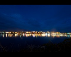 Downtown Victoria reflecting off the harbor ([nosamk] KMason photography) Tags: sky canada reflection water night clouds lights harbor bc britishcolumbia victoria nikonafsnikkor1635mmf4gedvr