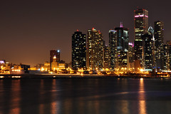 View From River East (Seth Oliver Photographic Art) Tags: chicago reflections illinois nikon midwest skyscrapers cityscapes lakemichigan navypier nightshots pinoy downtownchicago chicagoskyline urbanscapes 30secondexposure longexposures chicagoist cityskylines rivereast d90 wetreflections modernbuildings moderncities setholiver1 aperturef180 18105mmnikkorlens tripodmountedshot nocturneimages remotetriggeredshot shutterspeedprioritymode urbanskylinesatnight nightexpsoures noppexceptforminorperspectivecorrection