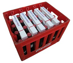 Model AidPods in a Coca-Cola crate