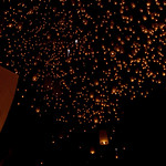Sky lanterns float into the night