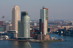 20110320_Rotterdam_0006 (Guido Akster) Tags: new york city bridge sunset sea sky urban building tower industry water netherlands metal architecture clouds port work hotel harbor pier boat office twilight rotterdam marine colorful downtown industrial ship commerce place skyscrapers sundown erasmus ships towers transport working terminal warehouse business international maritime transportation wharf montevideo elevated maas facility globalisation import trade exchange guido freight zuid eiland noorder erasmusbridge enginering cityimage seafreight retska akster cruisetermina