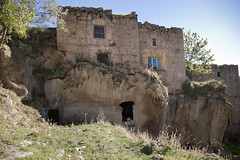 Two Stories_5842 (hkoons) Tags: cliff house home stone turkey asia hole earth mason masonry ground tunnel housing blocks cave domicile mideast anatolia abode dwelling earthen buildingblocks guzelyurt gzelyurt asiaminor