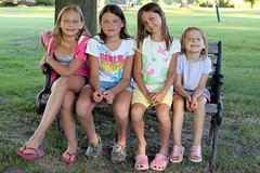 We're all sisters (Jenn Durfey) Tags: park family girls summer tree sisters bench happy toddler sitting sunny resting parkbench bestfriends preteen girlsmiling girlssmiling portraitofagirl parksetting portraitofgirls