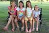 We're all sisters (Jenn Durfey) Tags: park family girls summer tree sisters bench happy toddler sitting sunny resting parkbench bestfriends preteen girlsmiling girlssmiling portraitofagirl parksetting portraitofgirls