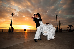 Love and Awesomeness (Extra Medium) Tags: wedding sunset groom bride pier kiss pumps evelyn jimmy husband wife heels bouquet redondobeach