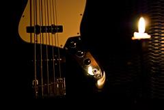 Arde sempre e non muore mai (scarpace87) Tags: light music reflection dark fire candle bass guitar fender musica passion strings candela luce fuoco buio riflesso passione corde basso jazzbass 105mmf28