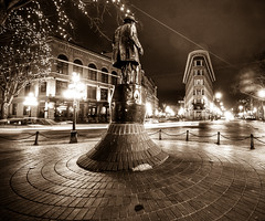 Gassy Jack (Brandon Godfrey) Tags: old city urban canada monochrome statue sepia night vancouver outdoors photography bc artistic britishcolumbia bricks barrel pacificnorthwest historical lighttrails gastown flatiron hdr highdynamicrange gassyjack traffictrails hoteleurope townscene