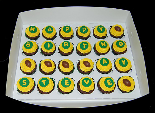 Green and yellow football birthday cupcakes for a Green Packers fan