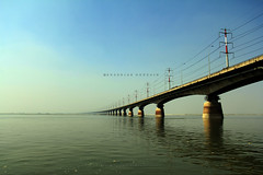 Jamuna Bridge (Shahriar Xplores...) Tags: sky white water canon river lens landscape boat interesting image wide wave wideangle bluesky l dhaka sell bangladesh ef f4 gettyimages aisa 17mm whitecloud riverscape 550d riverinteresting usmlens canonef1740mmf40lusmlens requesttolicense 550dlandscape canoninteresting shahriarphotography