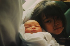 February 16 (denarose) Tags: sleeping baby film kids sisters children holding babies faces serious sister ishootfilm blanket newborn 365 bangs upclose littlesister pictureofapicture newlife newbornbaby seriousexpression filmpicture youngchildren 365photos filmphotograph sisterandsister 365dayblog denarose