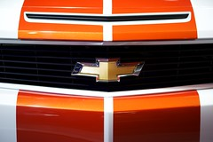 Chevy Badge (Joshishi) Tags: auto show orange white chicago cars chevrolet car illinois ss indy camaro chevy pace 2011 105mmf28dmicro