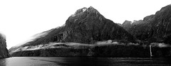 Milford Sound Panorama B&W (OneEighteen) Tags: newzealand sky bw panorama mist mountains water clouds reflections fjord milfordsound fiord fiordlands