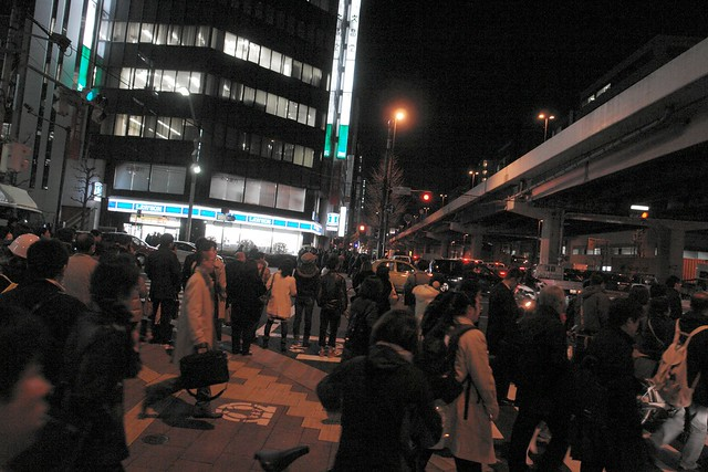 Akihabara Showa street :Many people walk street, all train stopped.