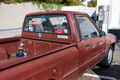 The Truck, The Window, The Munchy Lady, The Cigarette. (JulianBleecker) Tags: window truck 35mm stickers noflash f28 aperturepriority iso160 leicasummicronm35mmf2asph sec secatf28 3978093