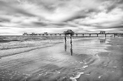 Day at the Beach (andrew_v) Tags: longexposure blackandwhite seascape reflection beach water landscape pier dock sand florida boardwalk clearwaterbeach hdr highdynamicrange seafoam clearwater niksoftware silverefexpro andrewvernon nikond300s aperture3 hdrefexpro