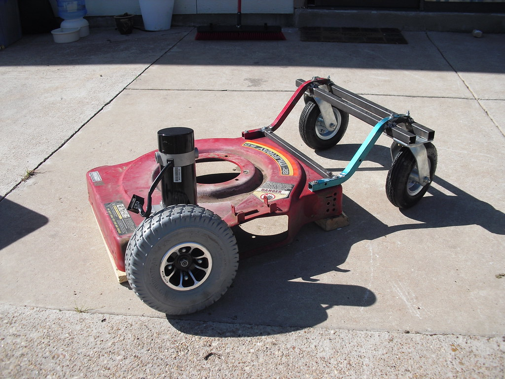 Pictured Here Are Two Wheelchair Motors With Wheels Attached Caster From A Furniture Dolly Lawnmower Frame Honda Civic Trunk Hinges