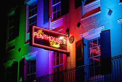 Lights, camera, action! (Michelle in NY) Tags: color reflection building colors sign club night dark louisiana neon balcony neworleans shutters handheld penthouse nola bourbonstreet changingcolors thebigeasy penthouseclub canoneos5d michellegreene michelleinny wwwmichelleneacycom michelleneacygreene