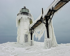 """Winters Art"" St. Joseph Northpier Lighthouse, St. Joseph, Michigan (Michigan Nut) Tags: winter usa lighthouse cold geotagged photography pier frost lakemichigan icicles catwalk iceformations bentonharbormichigan stjosephlighthouse nikon1635mmf4gedafsvrwideanglezoomlens"