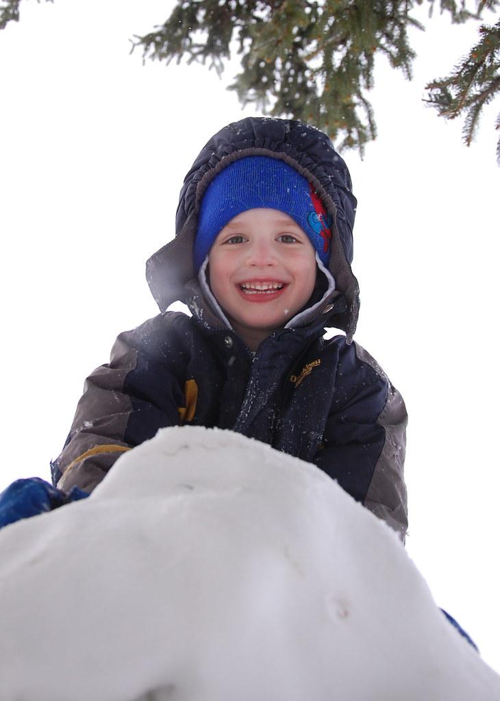 Alex climbing snowman