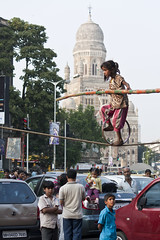 Tightrope-walking (Jos5941) Tags: poverty street india canon asia bombay acrobatics littlegirl asie mumbai begging inde cst victoriastation tightropewalking incredibleindia josfernandez