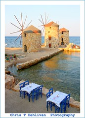 Tables by The Windmills (CTPPIX.com) Tags: old trip travel ladies sea summer vacation people mer reflection building beach architecture canon table island greek eos restaurant coast chair view urlaub aegean hellas windmills greece journey 7d gr ctp mills deniz masa 2010 chios griekenland milis griek hios hellenic greekisland xios sakiz grek yeldegirmeni greekwomen chiostown khios christpehlivan ctppix sakizadasi xioy imiloi