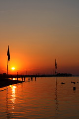Admiring the sunset (Lollinuz) Tags: light sunset red sea summer people italy orange sun hot color colour beach nature water colors beautiful beauty sunshine canon eos evening coast seaside shiny colorful warm italia mare colours afternoon shine natural bright sweet dusk flag shoreline rimini flags sunbath falling clear shore saturation romantic colourful pure shining brightness sunbathing admiring sera glut romagna cattolica admire gabicce 450d