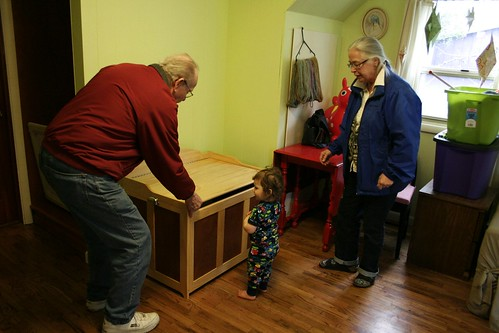 Papa Henry demonstrates the properties of the magic chest.