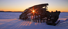 Inner light (KarenR-TB) Tags: winter snow ice sunrise skeleton boat shadows lakesuperior