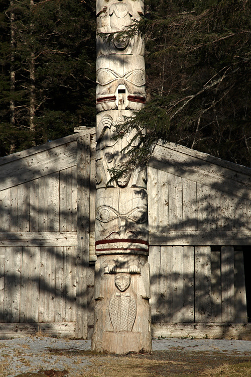 shadows on front of Chief Son-i-Hat Whale House and totem, Kasaan, Alaska
