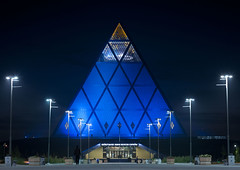 Palace of Peace and Reconciliation - Astana Kazakhstan (Eric Lafforgue) Tags: lighting blue people building monument horizontal architecture night outside outdoors person exterior nightshot pyramid streetlamps streetlights capital structure bleu nightview capitale centralasia kazakhstan nuit pyramide kazakh modernarchitecture personne humanbeing sights easterneurope lampadaire batiment eclairage astana brianclarke streetlighting edifice dehors eclairagepublic fosterandpartners exterieur photodenuit vueexterieure казахстан etrehumain palaceofpeaceandreconciliation akmola akmolinsk achitecturemoderne kz8311 palaisdelapaixetdelareconcialiation