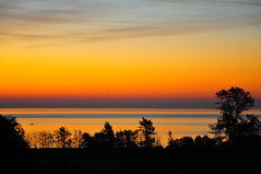 Sunrise Over the Ocean (vibrant_art) Tags: ocean blue trees red orange canada mountains beach water silhouette clouds sunrise interesting view vibrant victoriabc esquimaltlagoon