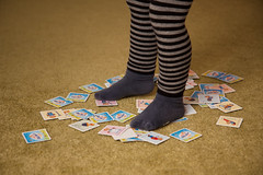 (slezo) Tags: girl canon cards legs stripes indoors babygirl 1755 canonefs1755mmf28isusm 1755f28 40d 580exii canon40d canonspeedlite580exiiflash