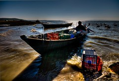 Pelican and fisher (Nejdet Duzen) Tags: trip travel lake turkey boat trkiye pelican fisher pelikan sandal gl manyas turkei seyahat bandrma balk saariysqualitypictures mygearandme bereketliky bereketlivillage