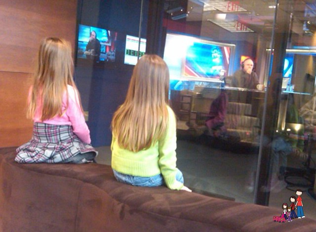 The girls watch Dave Ramsey at work