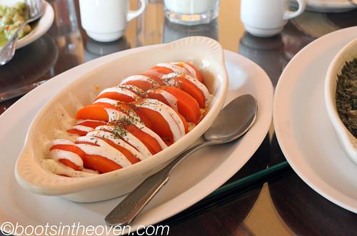 Borani Kadoo - seasoned pumpkin topped with yogurt and herbs