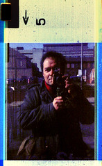 "reflected self portrait with ""Action Man"" camera (pho-Tony) Tags: camera man color colour film home statue analog vintage toy soldier army photography diy photo video memorial war doll boots action cam military 110 ishootfilm plastic negative novelty camouflage figure kit 1995 analogue pocket figurine expired warmemorial macho camcorder cameraman instamatic actionman cartridge developing c41 filmisnotdead tetenal colortec pocketinstamatic palitoy palitoyactionman"