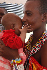 Maasai woman holds an infant (World Bank Photo Collection) Tags: africa portrait baby necklace holding women infant commerce kenya handmade working craft jewelry business bead vendor sell selling masai maasai gender hold worldbank beadwork