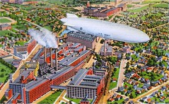 US Navy Airship Flying over Goodyear Plants (Smile Moon) Tags: ohio postcard navy zeppelin airship goodyear akron macon dirigible colortone curtteich curteich zrs4 zrs5