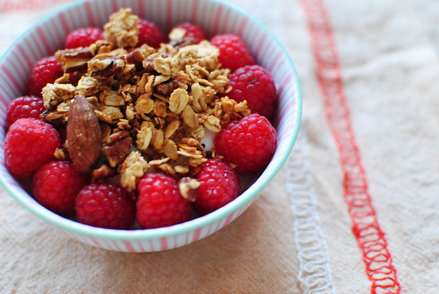 homemade granola with raspberries and greek yogurt