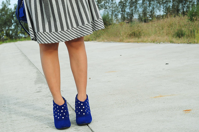grey striped dress and blue velvet boots