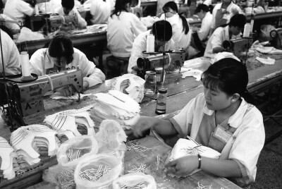 Young women workers in China making sneakers