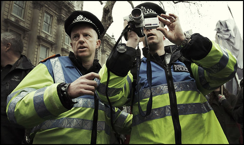 Police filming students during the anti-cuts demonstration in London 26.3.2011