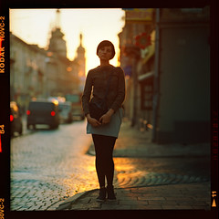 Down on the street (Denis Allbertovich) Tags: street light sunset sun color colour love 120 6x6 film girl beauty mediumformat square lights evening photo mood dof kodak bokeh lviv epson 160vc kiev88 v700 lemberg lwow leopolis kaleinar