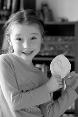 Very proud (christian_jacquet) Tags: show portrait girl smile proud children happy noiretblanc dessin presentation draw enfant fille sourire montrer fier heureuse