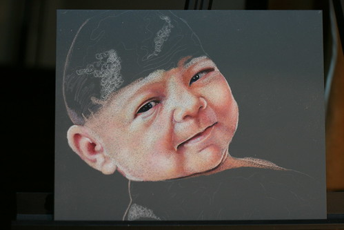 In progress colored pencil portrait of an infant entitled Alexandra.