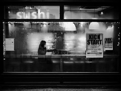 Sushi for one (Ian Brumpton) Tags: street blackandwhite bw london blancoynegro monochrome sushi blackwhite twilight noiretblanc candid streetphotography monotone explore sidewalkstories explored londonstreetphotography lifeinslowmotion ianbrumpton aimlessstrolling blackwhiteheartbeats londonatlarge