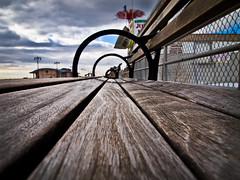 039/365 - February 8, 2011 - Riding The Pine (Shane Woodall) Tags: newyork texture lines brooklyn bench circle coneyisland boardwalk amusementpark 365 february 2011 project365 olympusepl1 3652011 shanewoodallphotography