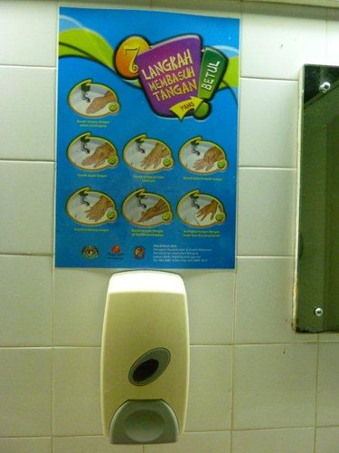 4b. Wash hands with soap poster but dispenser is soapless.
